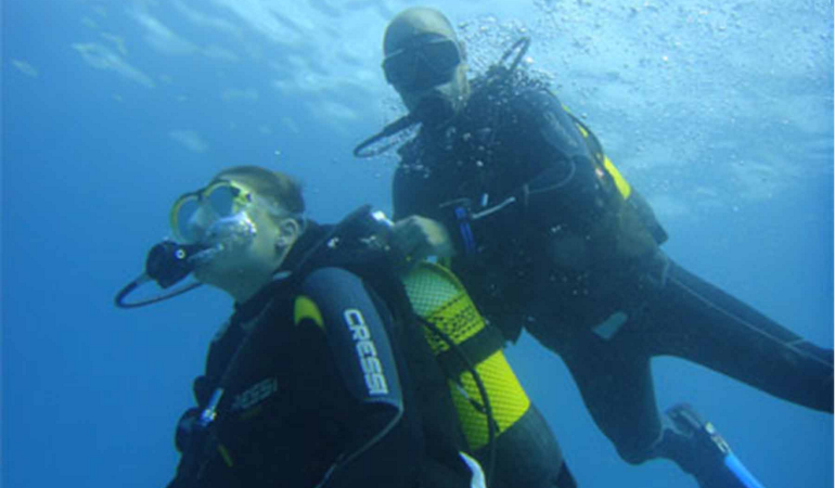 Diving instructor and participant
