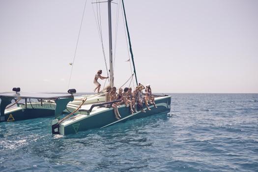 Big charter groups trip on Ecological Catamarans in Formentera, Ibiza