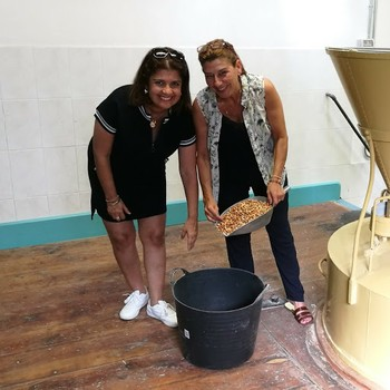 Hosts Lourdes and Silvia. The grain mill