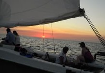 Sunset on catamaran in Menorca shared