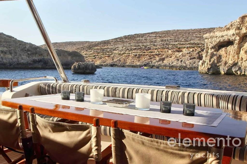 Yacht Charter in Ibiza: Aicon 90 dining area with beautiful view.