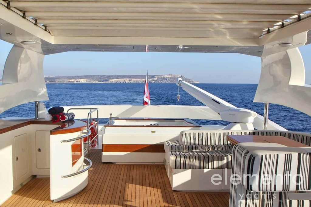 Yacht Charter in Ibiza: Aicon 90 flybridge with jacuzzi, couch and outdoor galley.