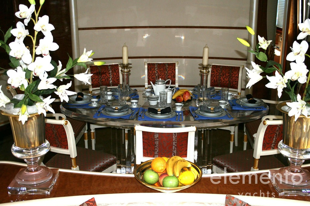 Yacht Charter in Majorca: Elegance 95 dining table in the salon.