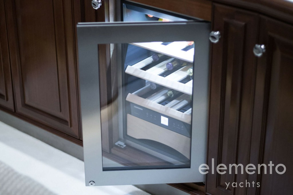 Yacht Charter in Majorca: Palmer Johnson 120 refrigerator for wine.