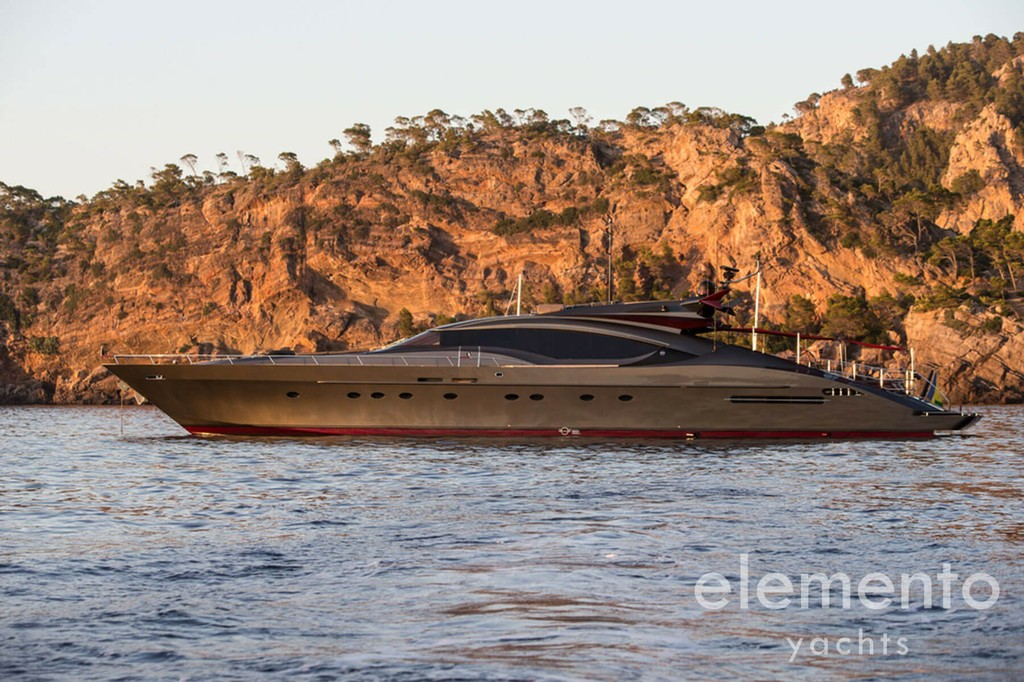 Yacht Charter in Majorca: Palmer Johnson 120 at anchor.