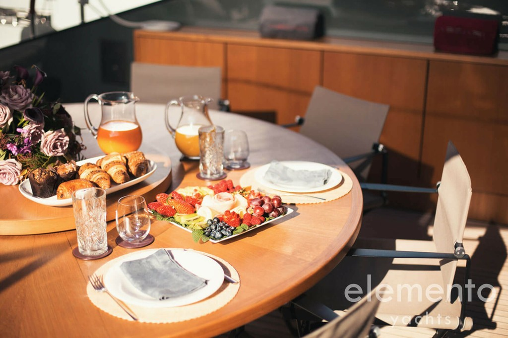 Yacht Charter in Majorca: Palmer Johnson 120 table with nice breakfast.