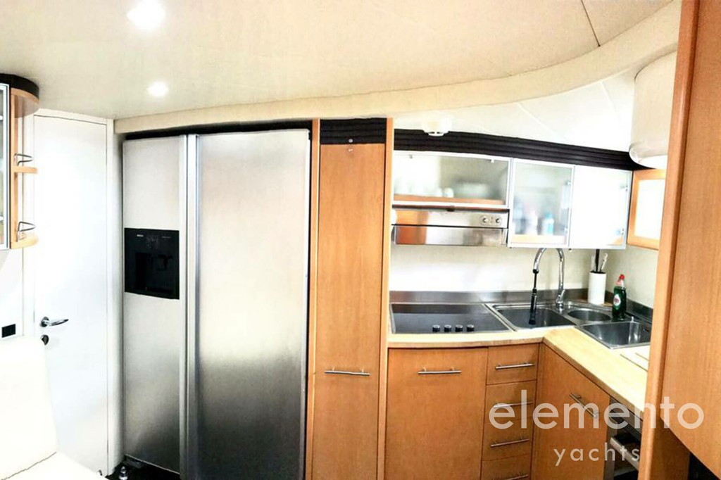 Yacht Charter in Majorca: Pershing 76 galley in the crew area.