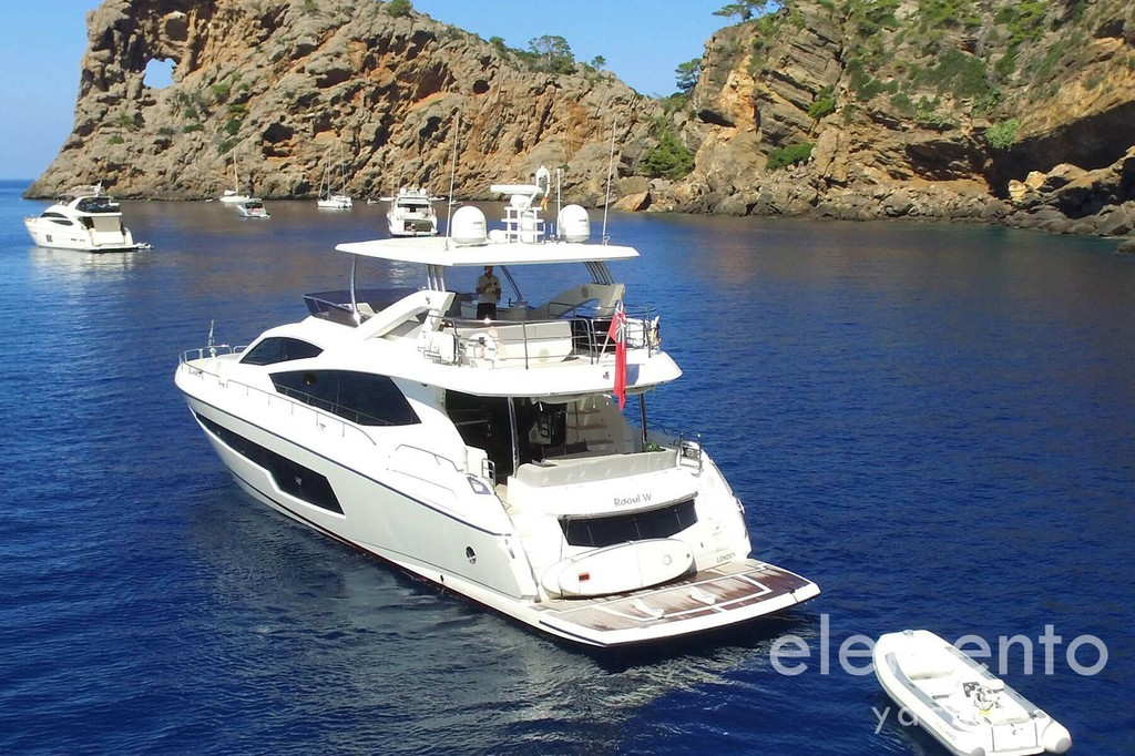 Yacht Charter in Majorca: Sunseeker 75 at anchor.