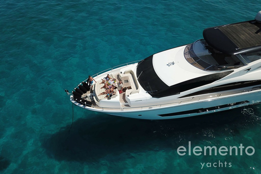 Yacht Charter in Majorca: Sunseeker 86 Yacht bow dining and sun pad area.