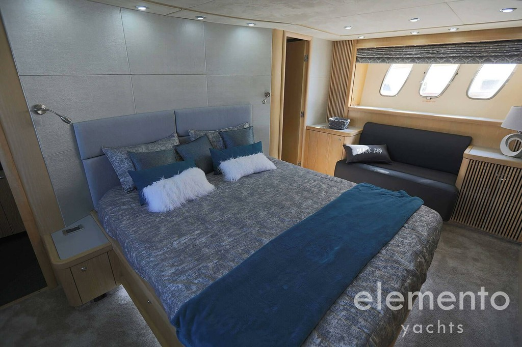 Yacht Charter in Majorca: Sunseeker Predator 82 luxurious master cabin with large bed.