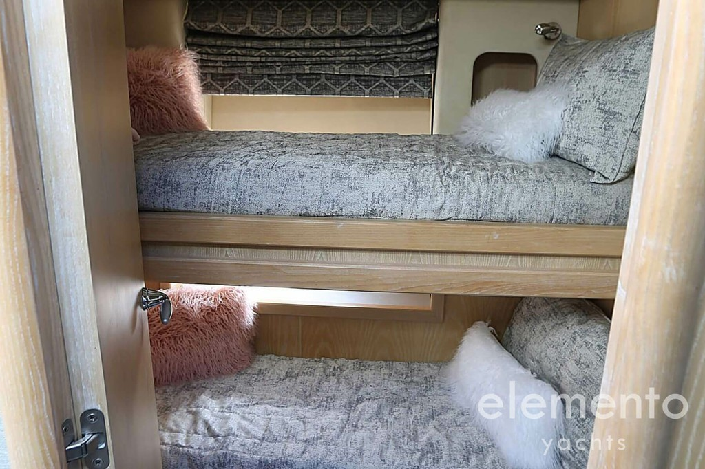 Yacht Charter in Majorca: Sunseeker Predator 82 double cabin with bunk beds.