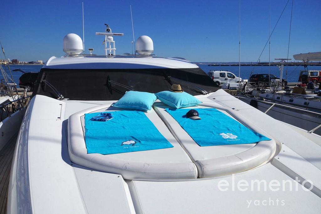 Yacht Charter in Majorca: Sunseeker Predator 82 bow sunbathing area.