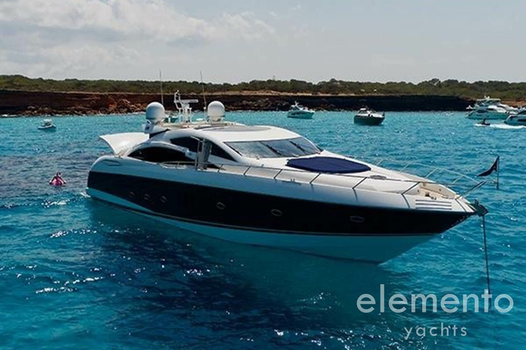 Yacht Charter in Majorca: Sunseeker Predator 82 at anchor.